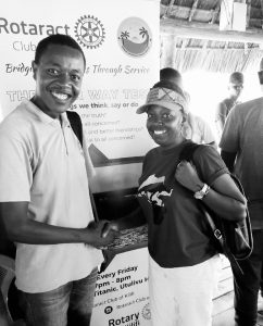 Rotaractor Peter and Alice shaking hands