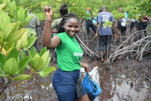 A happy rotaractor after planting mangroves